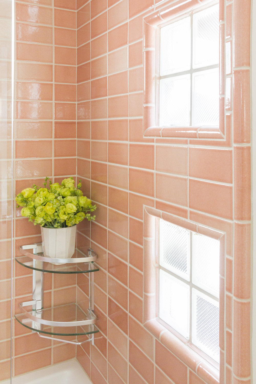 The bath and shower feature locally sourced handmade ceramic tiles in a coral gloss.
