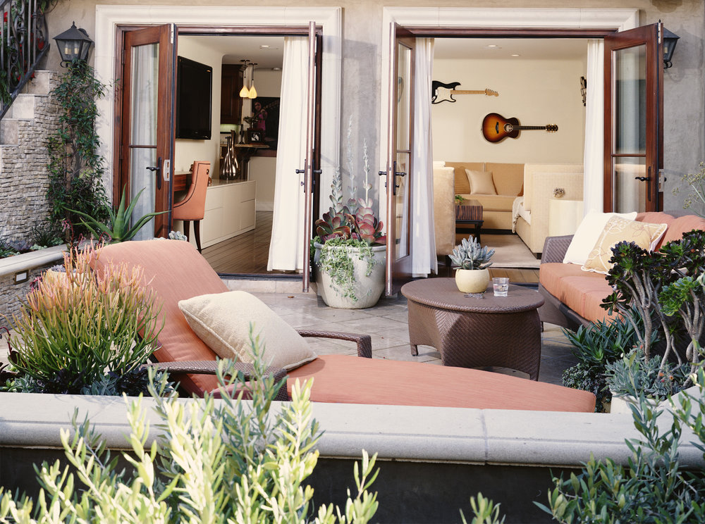Coral and lush greens create a lively and inviting atmosphere for an outside space.
