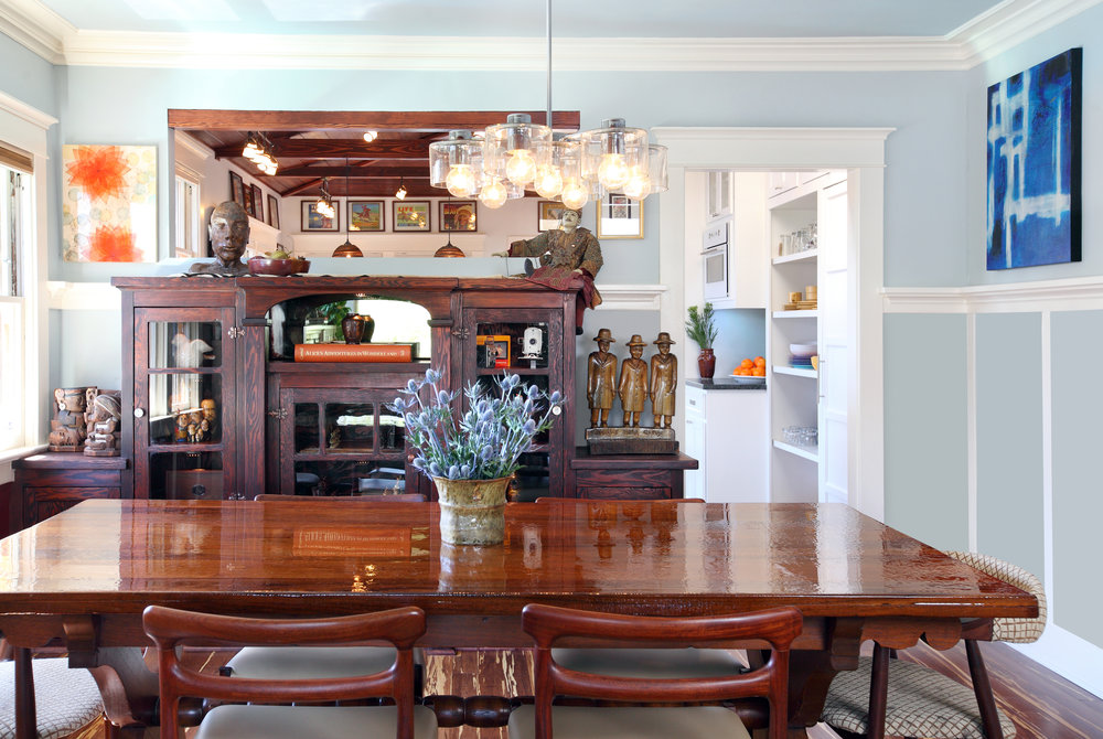 This dining room features fresh flowers, bright colors, and natural wood tones.