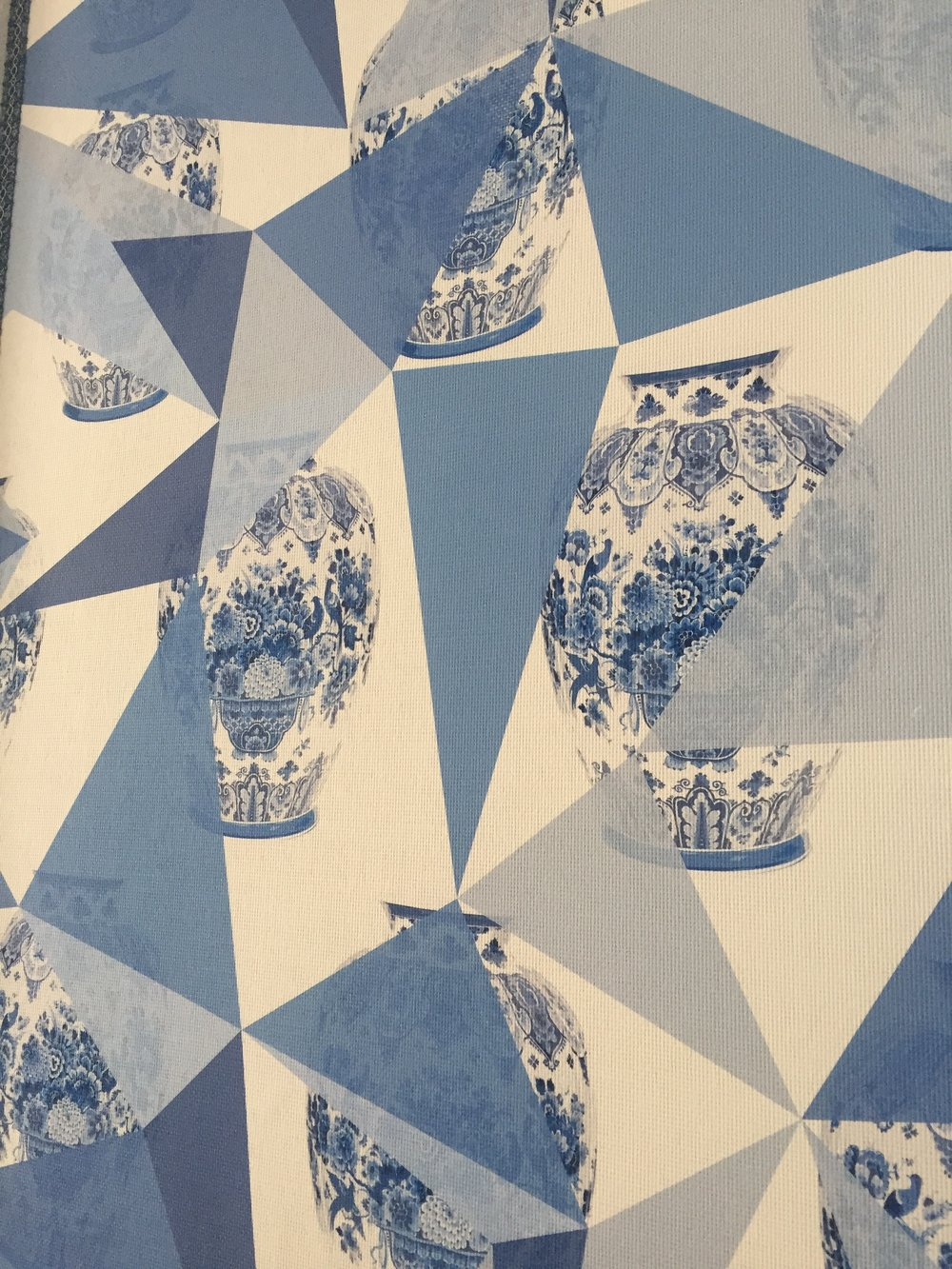 Modern-minded abstractions layer over classic blue-and-white porcelain motifs in the designer's grasscloth-on-paperwall covering by Nicolette Mayer for Scalamandré.