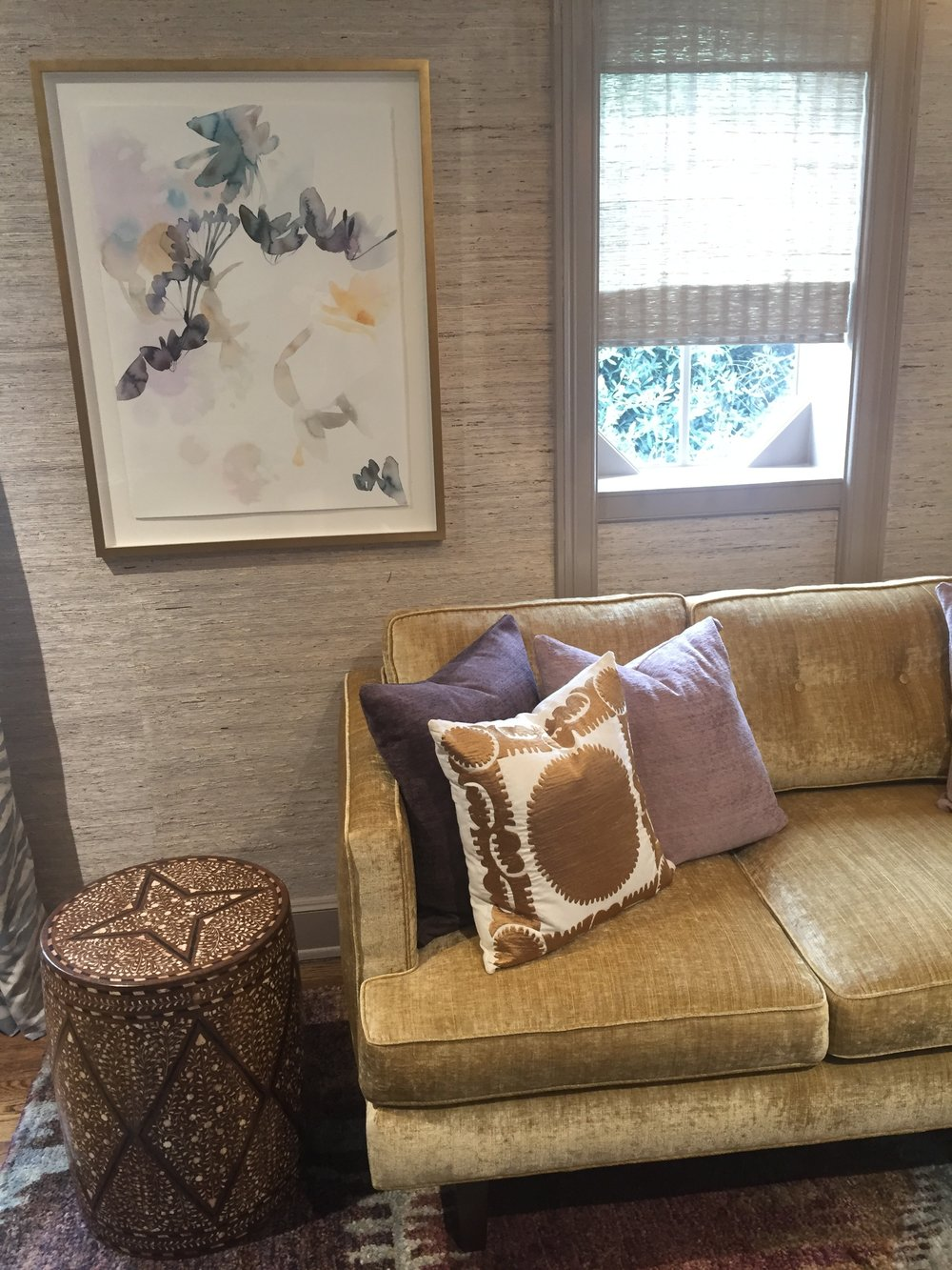 Warming colors and rich, natural textures combine in the Lady's Hideaway by The Art of Room Design.