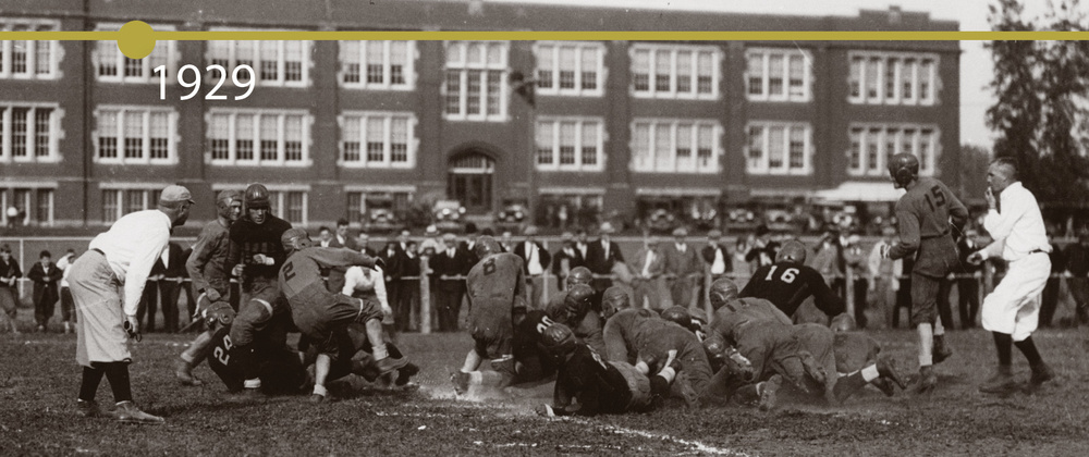 Before Carson Park became home to Blugold football games, many early games were played on a field south of Schofield Hall. Here we see the action from a 1929 game against River Falls Teacher's College.