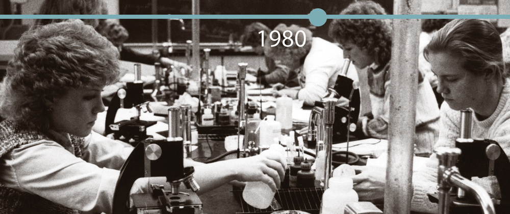 Biology students conduct experiments in this circa 1980 image.
