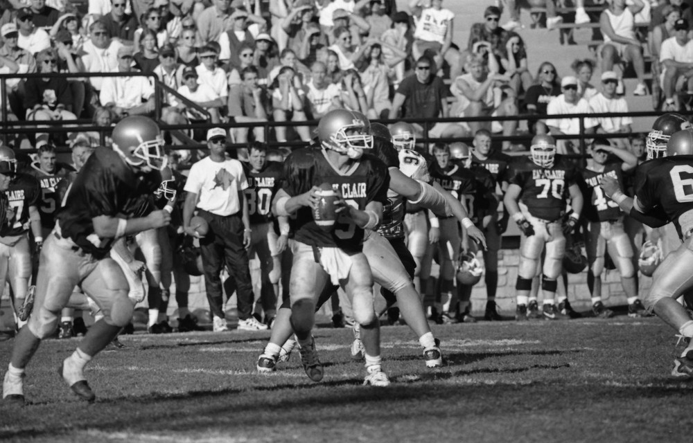 Quarterback Sean Hoolihan eyes the field in this scene from the 1997 Homecoming Football Game against UW-Stout.