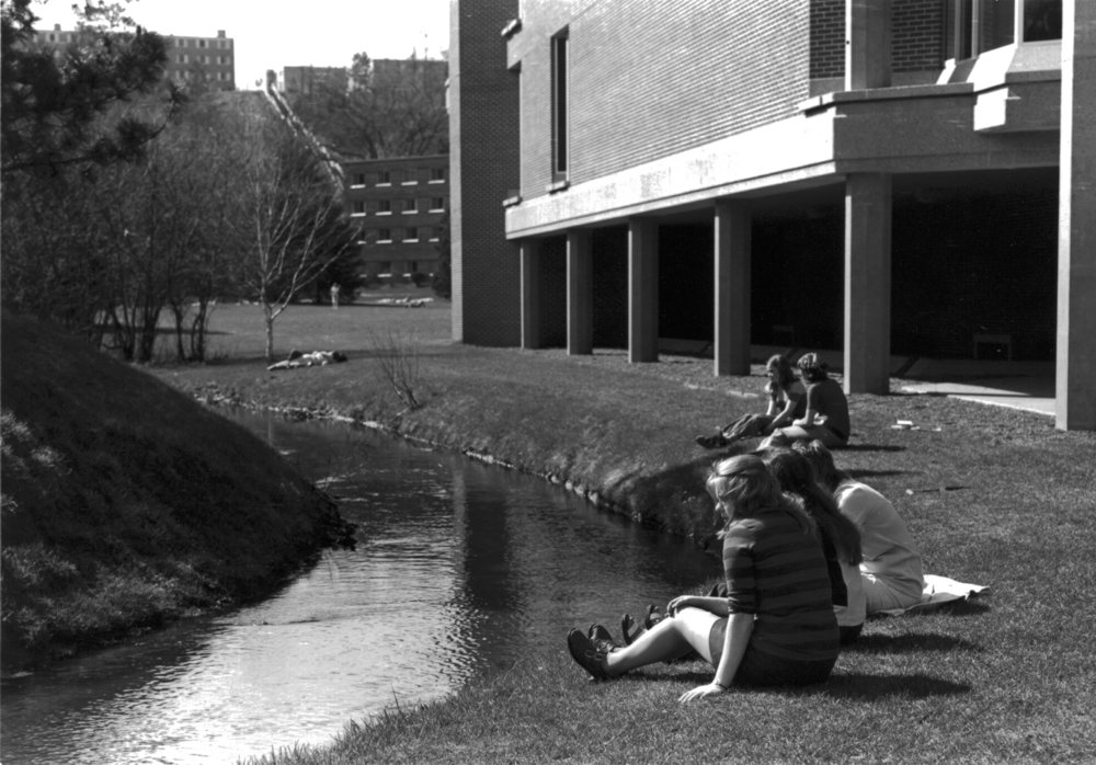 Students at shoreline near library, ca. 1973