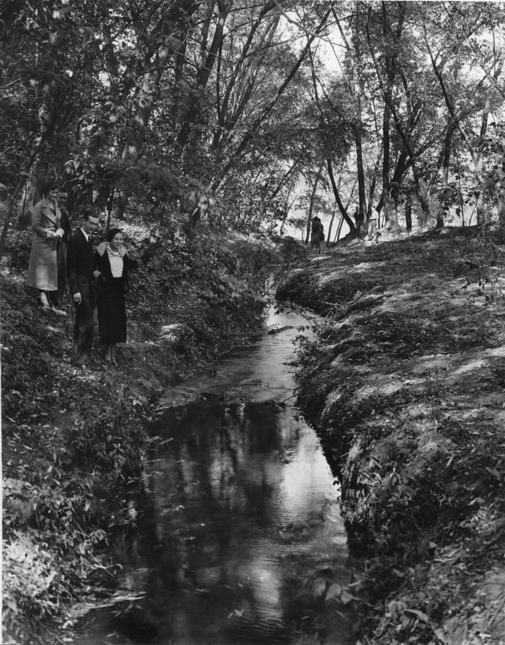 Students near river's mouth, ca. 1932