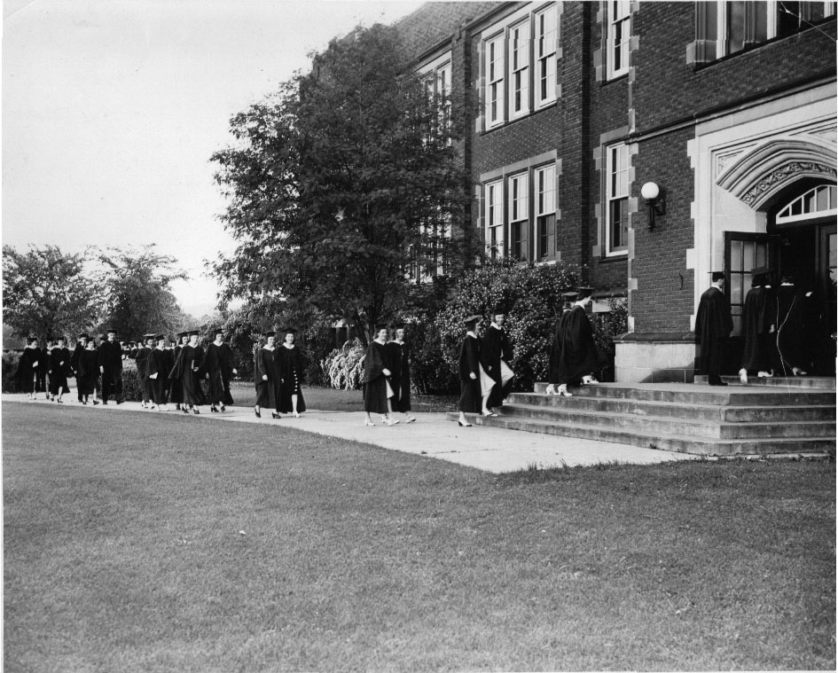 Graduates marching into Schofield Hall, 1940's