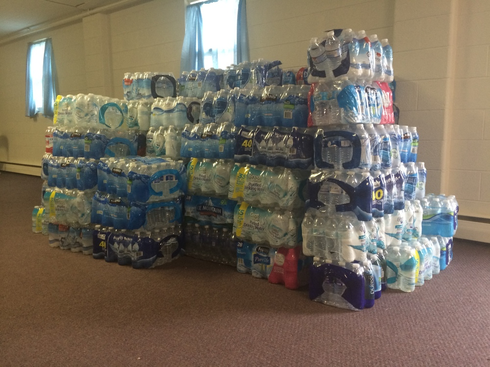 leaders are excited to see a truckload of water arrive from art van furniture at Bentley Church