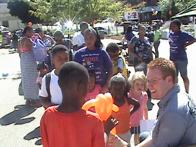 Jeff Veley meets with kids in the audience and makes balloon animals following a neighborhood performance.