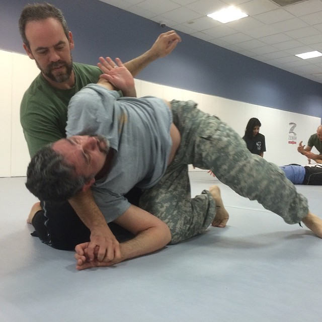 Instructors Carlos Guzman and Jeff Shearer work the finer points of limb control, at a jam-packed Friday night in Chapel Hill