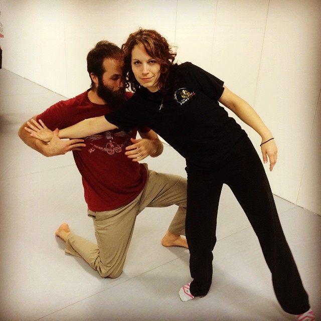 Amber appears unfazed by Marco's armlock. A fun night working with elbows in Chapel Hill