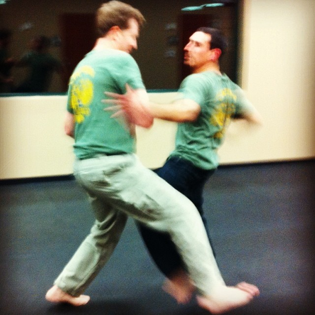 Noah deftly parries the leg, and prepares to unload another (Fish)bomb. A kickin' night of training in Clayton