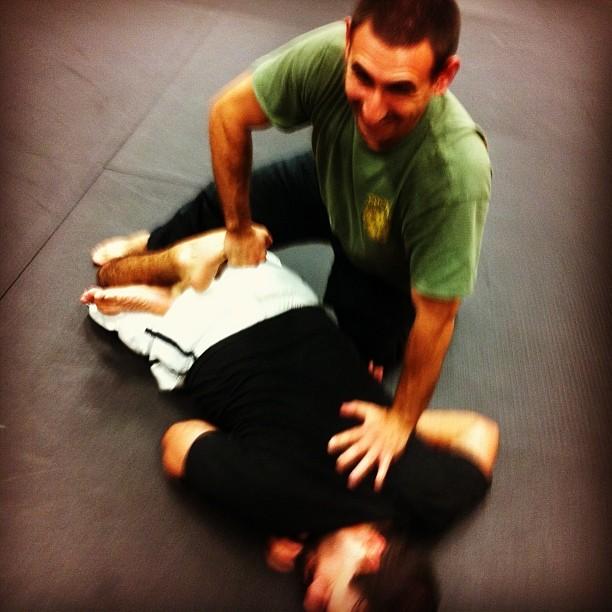 Noah pretzels Richard, at a fun Wednesday class at Revolution Self Defense