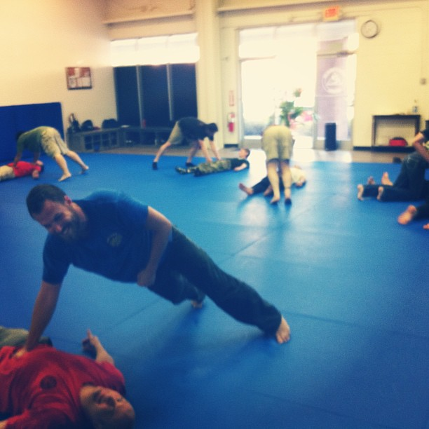 A great Friday night class in Chapel Hill, warming up for today's Fistfight seminar. Hero pose: Bryan and Russ