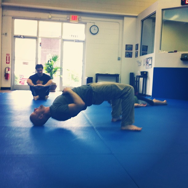Instructor Glenn Murphy works the neck at the Combat Conditioning seminar