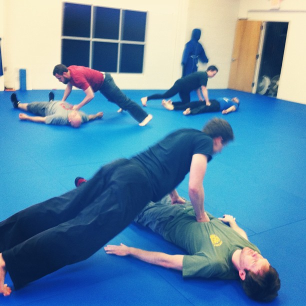 Warmin' up for Friday-night strikes, at the Chapel Hill Quest Center class