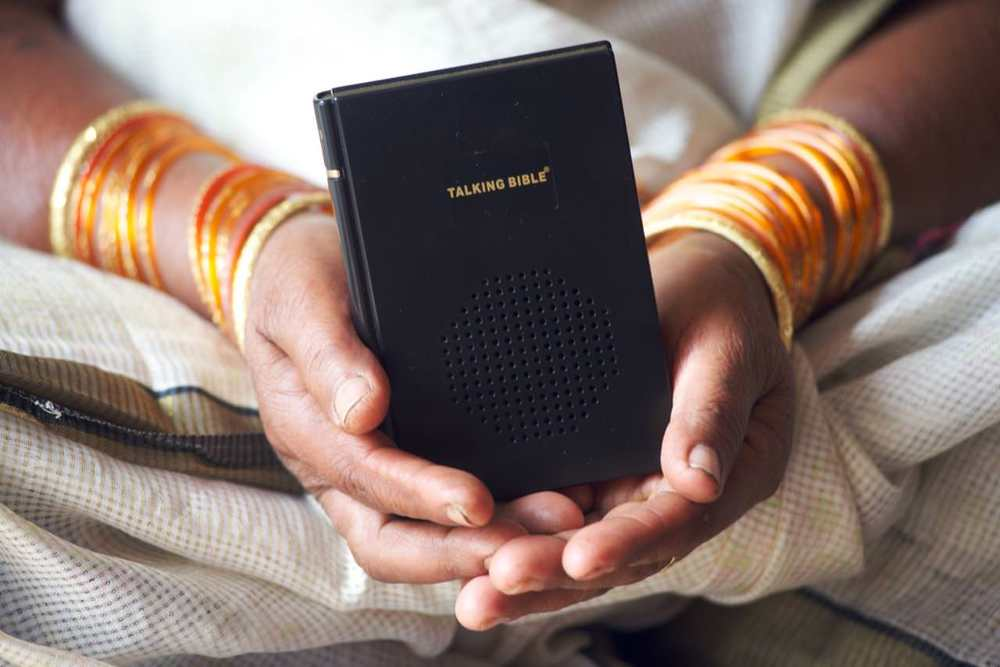 Susila holds her Talking Bible in her lap. Many women who receive Talking Bibles face persecution by their families because of their faith in Jesus Christ.