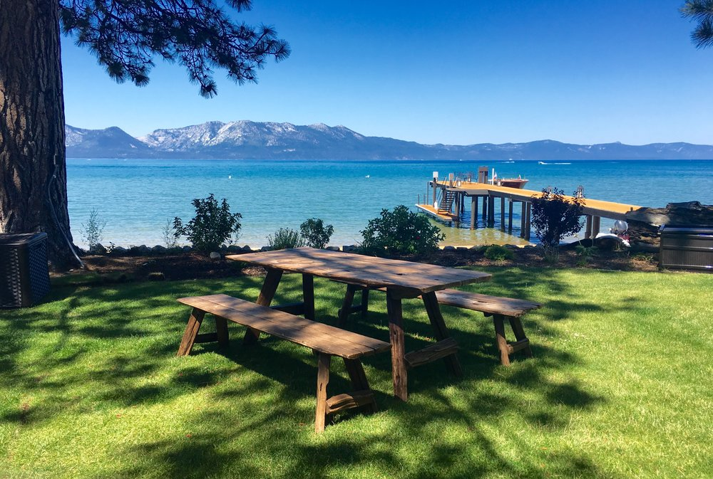 Picnic table made from reclaimed Teak seen on the shores of Lake Tahoe.