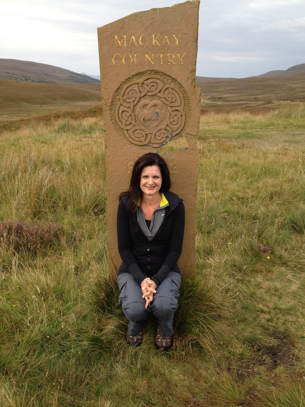 Theresa Mackay doing some ancestral tourism of her own in Scotland. Photo copyright and courtesy Theresa MacKay.