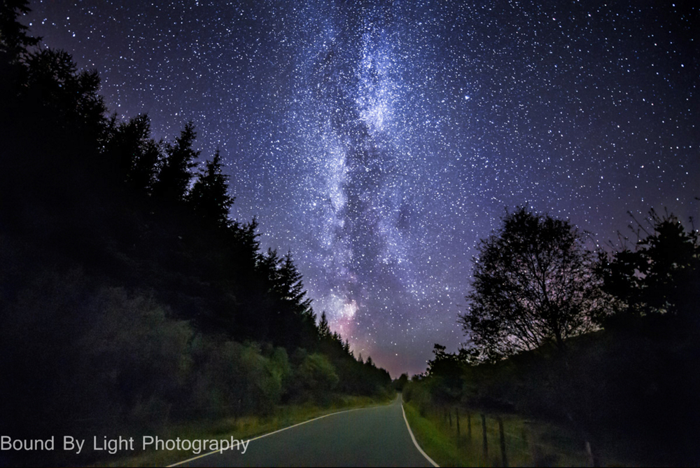 The Milky Way over the Argyll peninsula. It's as if you could drive right off the end of the earth and onward to an adventure in the stars! Image © Stuart McIntyre