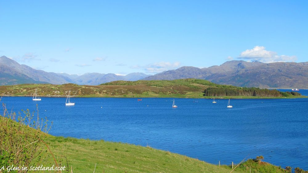 Sailboats anchored near the port town of Mallaig. Photo by author.