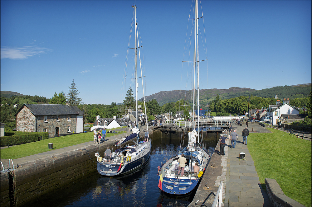 If sailing the open sea seems a bit too adventurous, Scotland offers inland canals and lochs as an alternative. Boats descending Fort Augustus Locks into Loch Ness © Peter Sandground