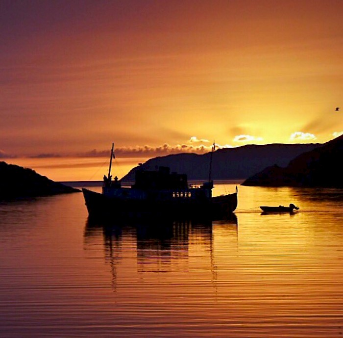 The end of a day of small ship cruising, a secluded anchorage and a remarkable Scottish sunset. Photo courtesy The Majestic Line/Gordon Howe.