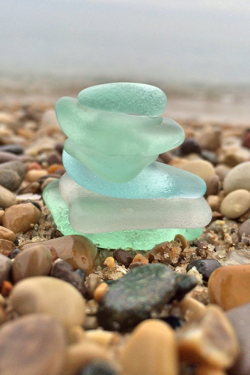 Lovely seafoam green glass is most commonly attributed to pre-1960's Coca-Cola bottles and other soft drinks like Dr. Pepper and Mr. Cola. The color falls between common and rare as it is no longer widely used.