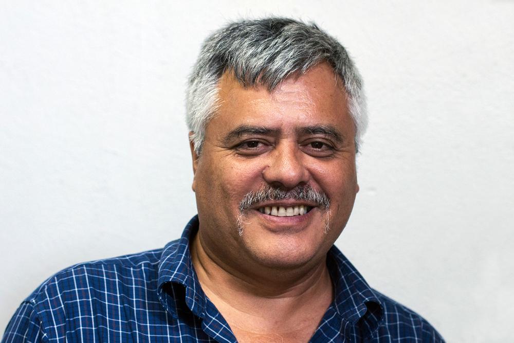 Ricardo in his office