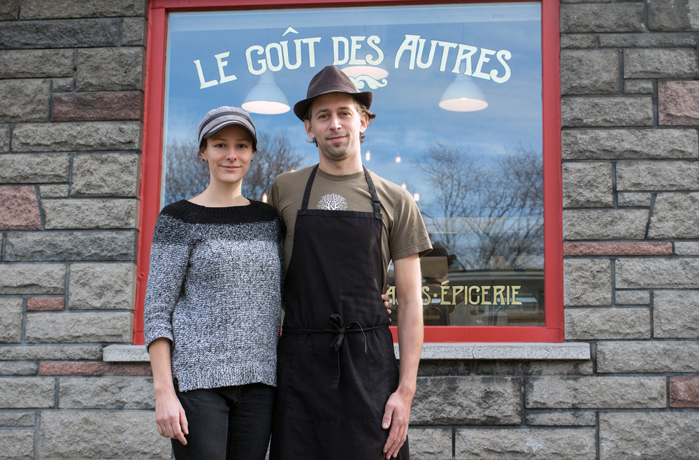 Fanny and Kévin in front of their shop on Sauvé Street East of the Metro