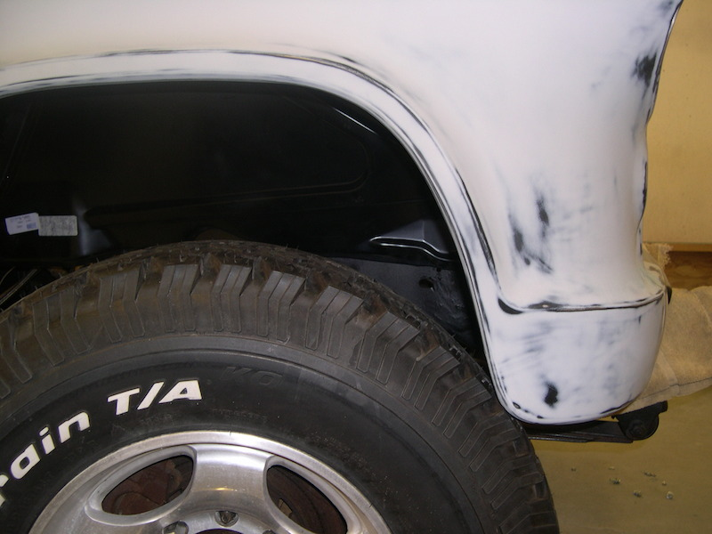 During pre-paint assembly see how the tire size interfered with the lower front fender. The next pictures show how this was fixed.
