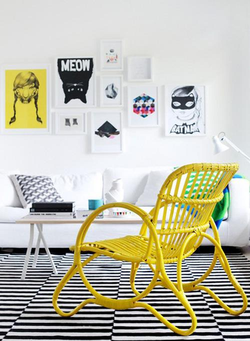 rattan chair + black and white floors + wacky art wall  (source)