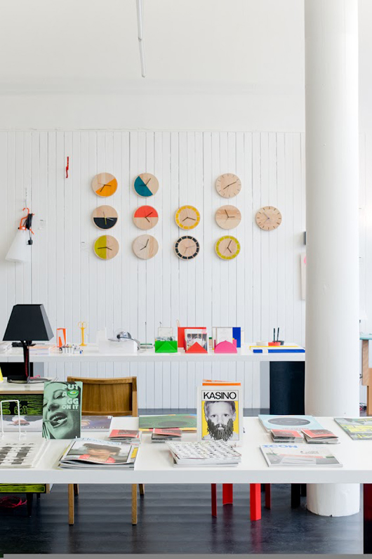 white walls + touches of warm wood + pops of neon color  (source)