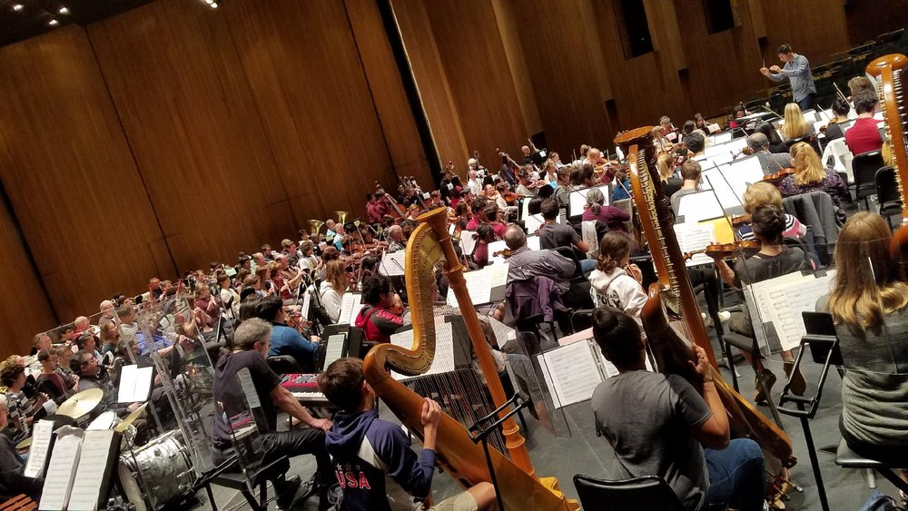 Daniel rehearses the Long Beach Symphony joined by students of the Long Beach All-District High School Honors Orchestra.