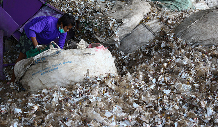 A worker sorts recyclable plastic waste outside of Bangkok, Thailand. 2017 Reuters