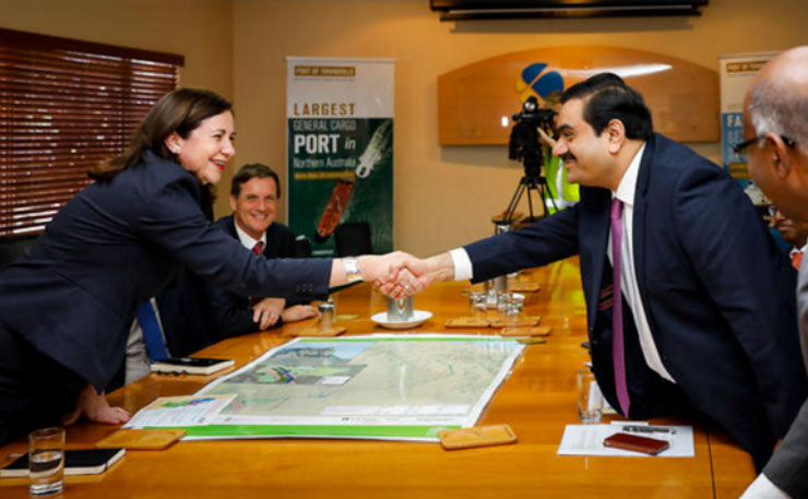 Queensland Premier Annastacia Palaszczuk shakes hands with Gautam Adani, Port of Townsville, 6 December 2016. (IMAGE: AAP)