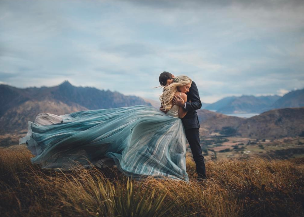 togetherjournal We can't get enough of our cover image by  @jimpollardgoesclick 💙 It was one of those images that takes your breath way the moment you see it. Carly + Elliot you make the perfect couple and you chose the perfect spot to marry 💙 Oh and that dress...