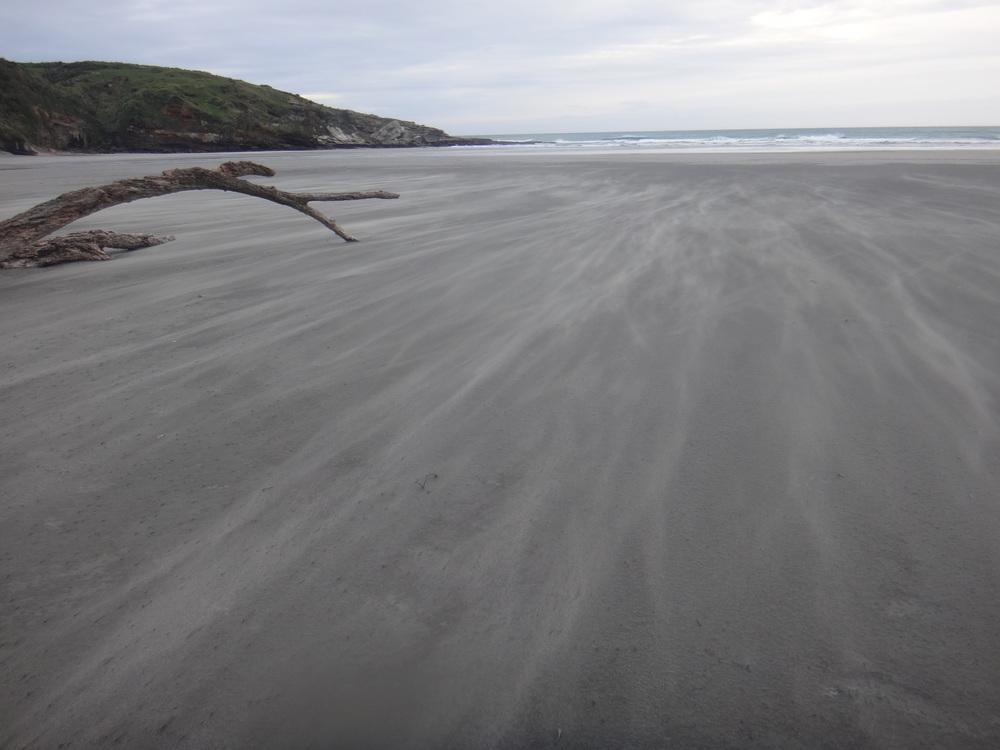 Flying sand.