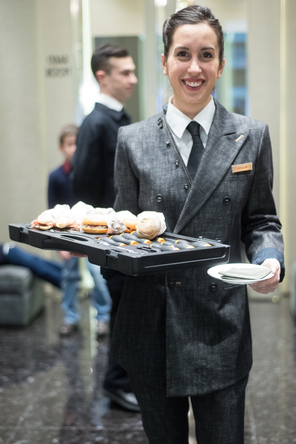 Serving delicious canapés staff in Gentucca Bini trouser suit