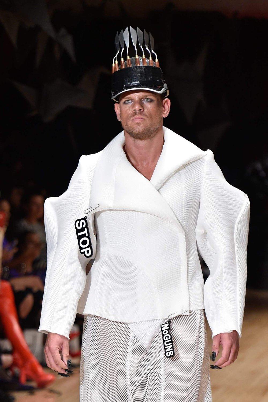 White airtex accessorised with slogan