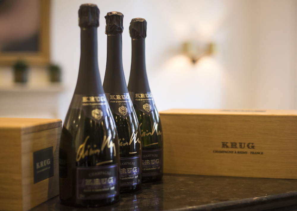 Limited-edition bottles of  Krug Clos d'Ambonnay 1998  champagne autographed by Olivier Krug to auction for  Save the Children .