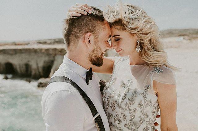 Windswept seas in Cyprus illuminate this beautiful couple's wedding day! Vassa is wearing the Claudia Earrings. Photography: @karinaleonenkophotography