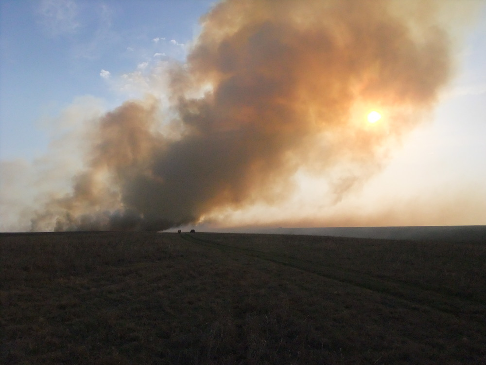A smoke column dispersing over the Tallgrass Prairie National Preserve in KS in 2012. HTLN photos.