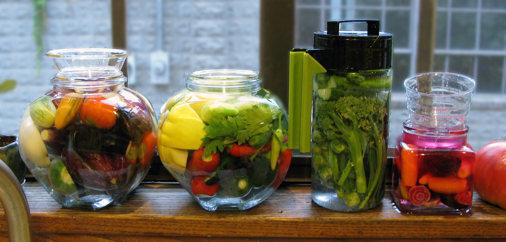 Pickles galore in a variety of vessels.