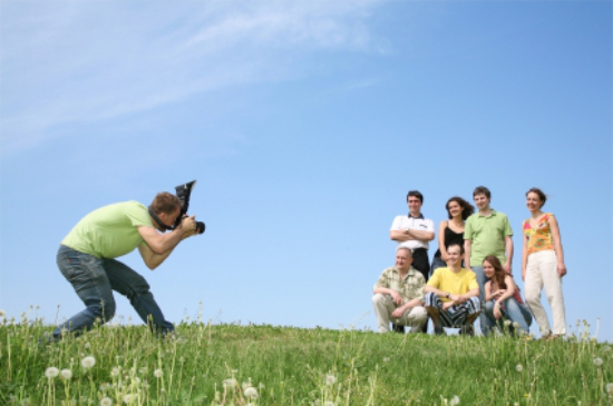 photographer-shooting-group-portrait-in-field.jpg