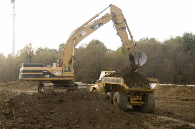 Loading of D400 Haul Trucks from borrow site to construct new floodplains and channels