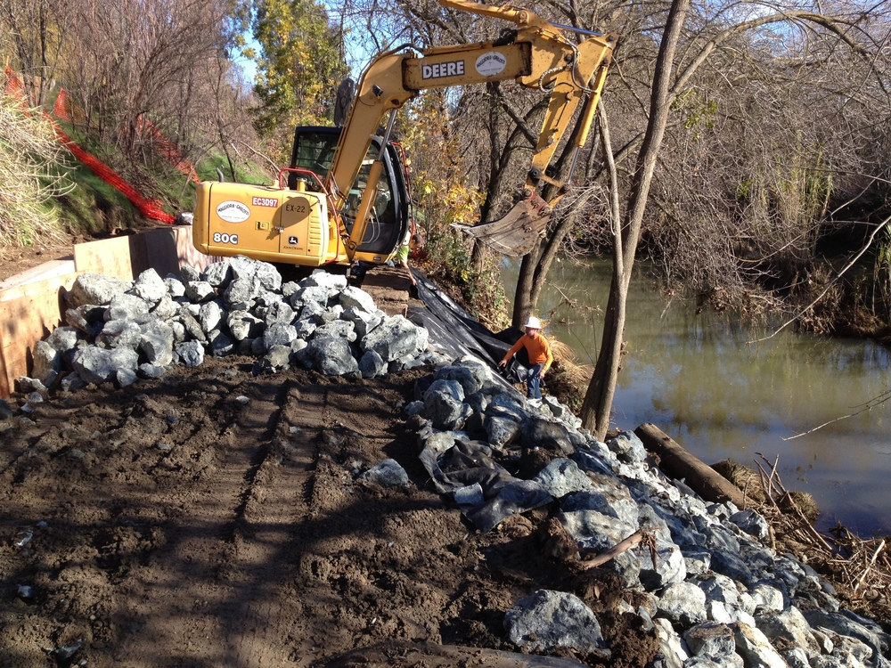 Placing Rip Rap on slope along active Putah Creek