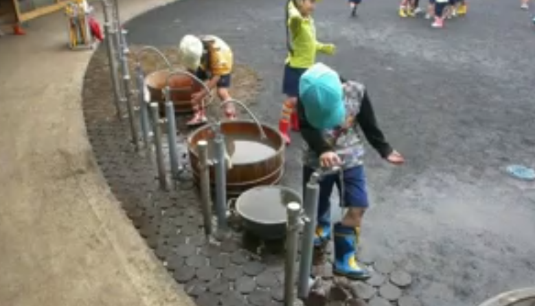 """  And the leg washing place -- there are many kinds of water taps.   You see with the flexible tubes,   you want to spray water to your friends,   and the shower,   and the one in front is quite normal.   But if you look at this,   the boy is not washing his boots,   he's putting water into his boots.  """