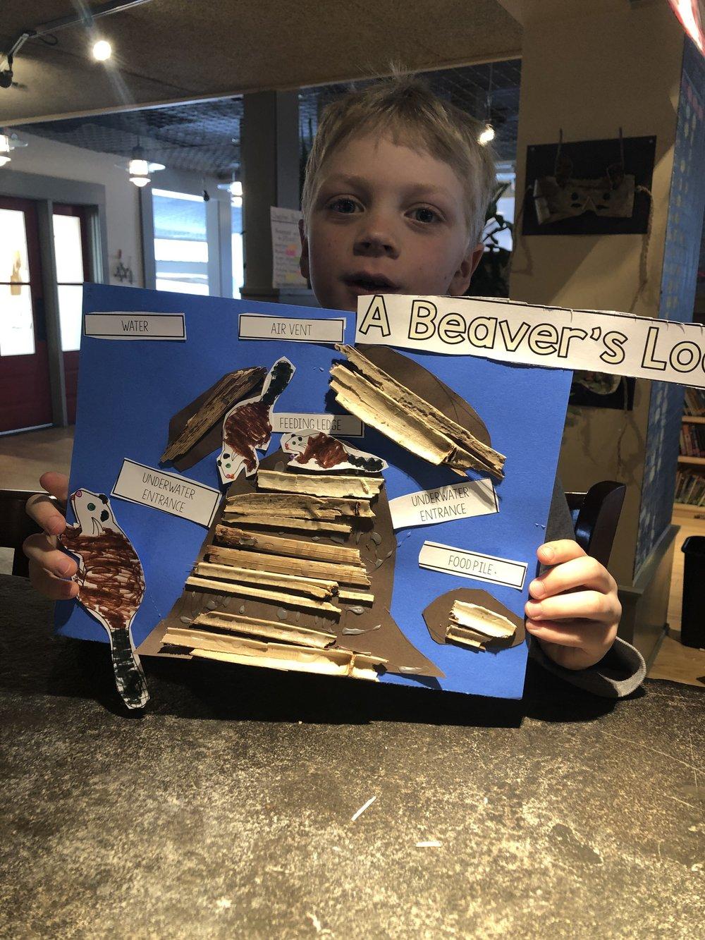 A student in the Rivers Class shows off his final diagram of a Beaver's Lodge.