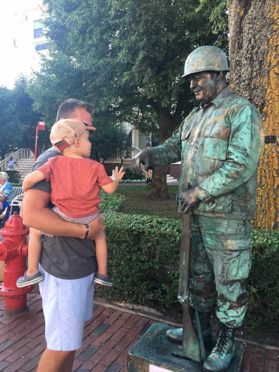 The Human Statue fist pumping with Jack. Read more about his  story here.